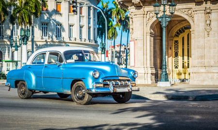 American blue classic car with white roof drilled on the main street in Havana Cuba - Series Cuba Reportage