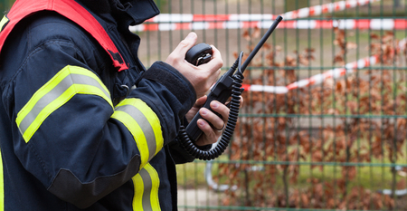 HDR - Firefighter operate with a walkie talkie in action - series Firefighter