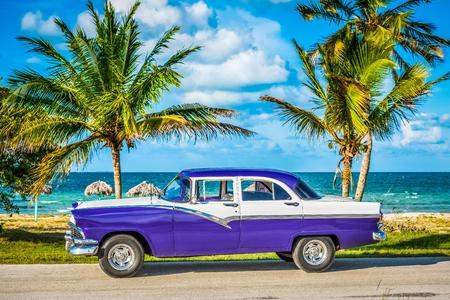 American blue vintage car parked on the coastline in Havana Cuba - Series Cuba Reportage