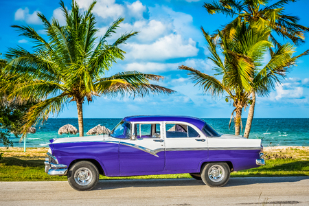 American blue vintage car parked on the coastline in Havana Cuba - Series Cuba Reportage