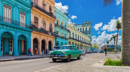 Cityscape with american green classic car on the main street in Havana city Cuba - series Cuba reportage