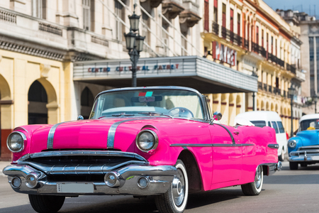 American pink convertible vintage car on the street in Havana City Cuba - series Cuba Reportage Editorial