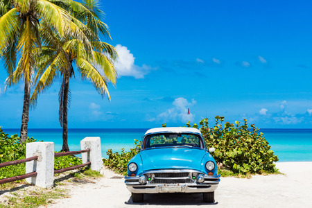 American blue classic parked car on the beach at Varadero Cuba - Series Cuba Reportage