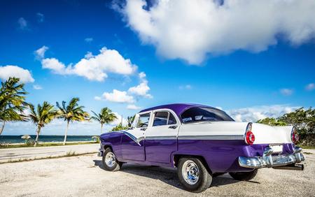 HDR - American blue parked car on the Malecon near the beach in Havana Cuba - series Cuba