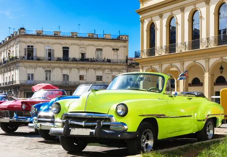 American yellow 1951 and a red 1957 convertible vintage car parked in the historical center from Havana City Cuba - Series Cuba Reportage Redactioneel