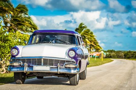 American blue white 1956 vintage car parked on the street near the beach in Havana Cuba - Series Cuba Reportage