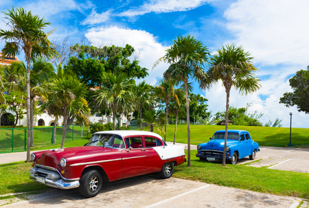 American red brown 1954 vintage cars parked under blue skies near the beach in Havana Cuba - Series Cuba Reportage