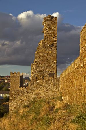 Sudak fortress in Crimea - towers and the wall at sunset. Stock Photo - 11781394
