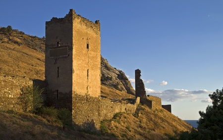 Sudak fortress in Crimea - towers and the wall at sunset. Stock Photo - 11781390