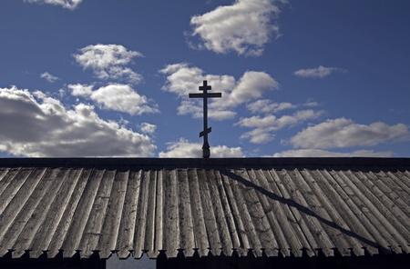 credo: Russia; Karelia; Kizhi Island. Wooden Orthodox cross in the sky.