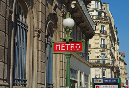 A typical metro sign on Paris street. photo