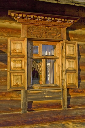 Ornamental window of the old rural wooden house. Suzdal, Gold Ring, Russia. photo
