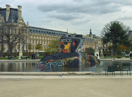 incompatible: Strange things sometimes appear near the Louvre Museum         Editorial