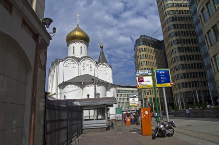believers: Old Believers  Church and the new office buildings Stock Photo