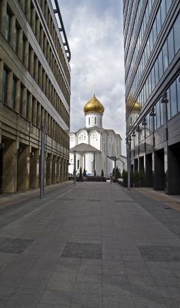 The road to the temple   Old Believers  Church and the new office buildings Stock Photo - 14568956