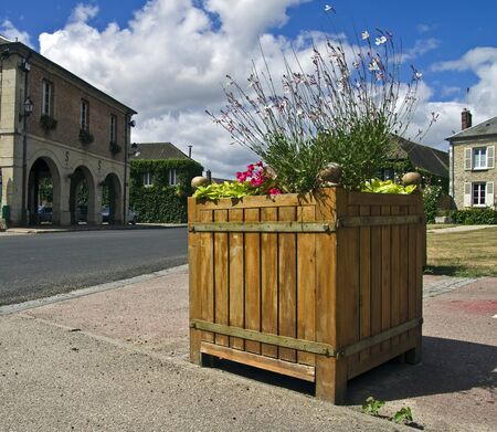 socle: The original flowerbed in the central square a small town in Normandy, France