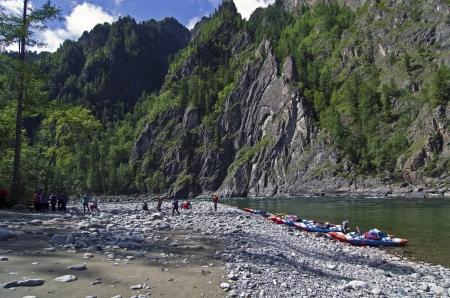 A group of tourists in the canyon Orho-Bom, Sayan Oka river, Eastern Sayan, Siberia, Russia