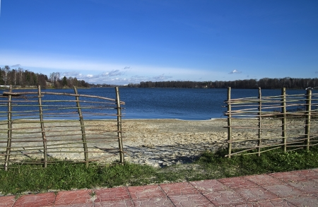 Empty lake beach in a cold autumn day photo