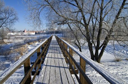 Pedestrian bridge on a clear frosty winter day  Suzdal, Russia Stock Photo - 17742708