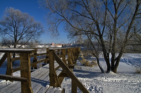 Pedestrian bridge on a clear frosty winter day  Suzdal, Russia  photo