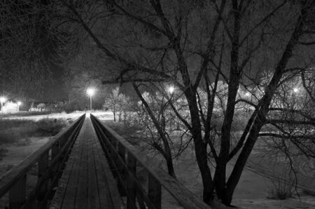Night view on a footbridge in a small provincial town  Suzdal, Russia  photo