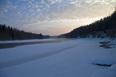blanch: Non-freezing river in the early winter morning