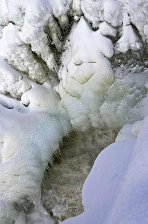 blanch: Bizarre ice stalactites on the frozen waterfall  Kivatch waterfall, Karelia, Russia  Stock Photo