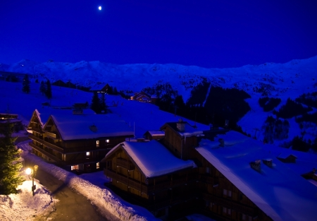 Moonlight lanterns: View of the valley of Meribel at night  France