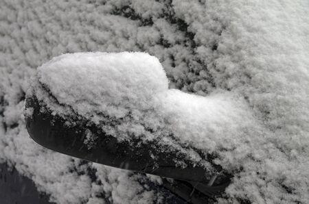 blanch: A snowy car mirror in heavy snow
