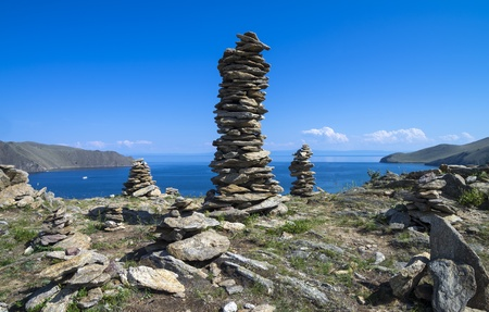 The buddhist traditional stone pyramids on the shore of Lake Baikal  Siberia, Russia photo