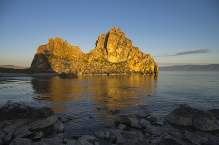 Shamanism is considering Shaman Rock as one of the main centers of power in the world  Olkhon, Lake Baikal  Stock Photo - 21857484