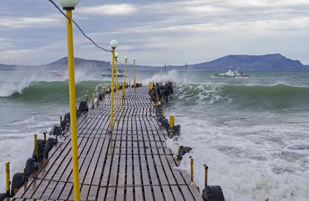 Wave fills a small jetty  Crimea, the Black Sea coast