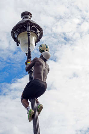 Acrobat with a soccer ball in Montmartre, Paris, France