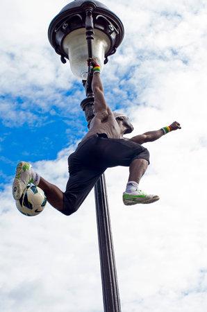 sportsmanship: Acrobat with a soccer ball in Montmartre, Paris, France