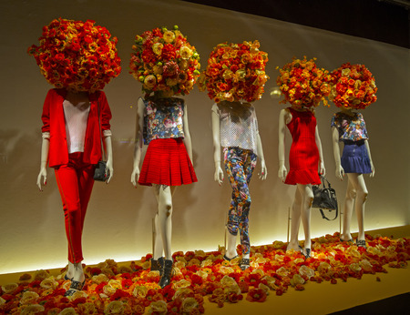 Mannequins in the showcase of a  department store in Paris, France
