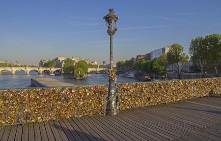 love proof: Too many locks of love on the railing of a bridge over the Seine in Paris  Editorial
