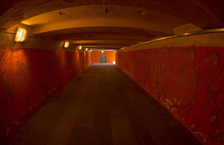 underpass: Empty underpass in red tones with lights