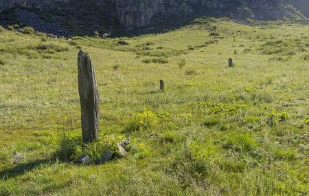 katun: Three-stone menhirs, Altai, Russia. Katun river bank Stock Photo