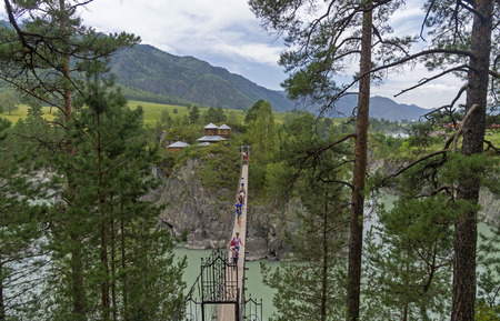 chemal: Suspension bridge to the monastery on the island of Patmos, Altai, Russia. The island got its name in honor of the Greek island of Patmos.