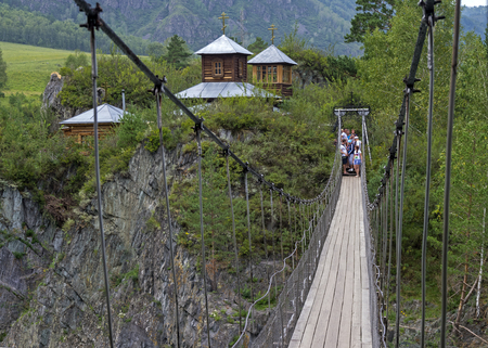 katun: Suspension bridge to the monastery on the island of Patmos, Altai, Russia. The island got its name in honor of the Greek island of Patmos.