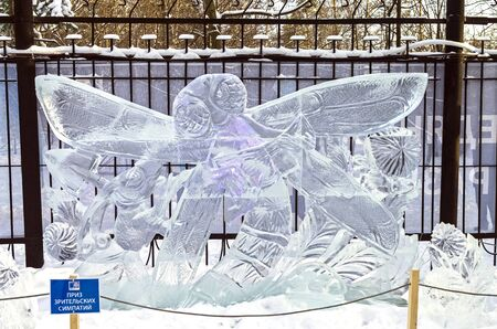 ant: Ice sculpture - Dragonfly and Ant. Illustration  Stock Photo