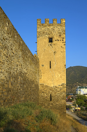 Genoese fortress in Sudak. Tower and fragment of the wall. One of the few non-destroyed towers.