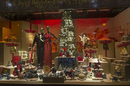 Festive window dressing in Parisian department stores for Christmas.