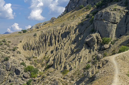 weathering: The results of weathering and leaching of rocks on the hillside. Crimea, cape Meganom.