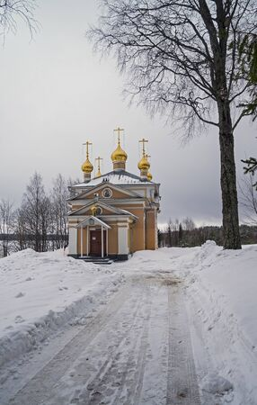 cloud drift: All Saints church in Orthodox monastery. Vygozero, Karelia, Russia. Early March, cloudy day.