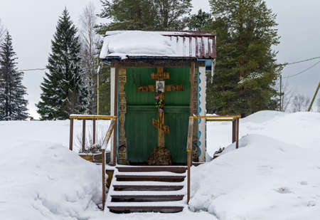 credo: Worship cross in the Orthodox Monastery. Vazhozero, Karelia, Russia. Stock Photo