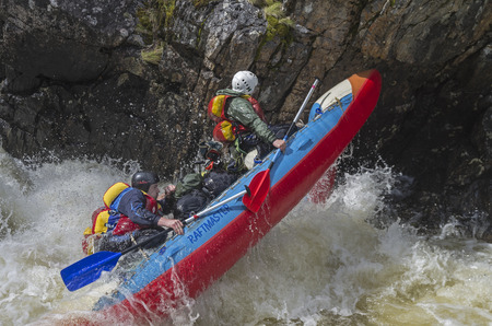 extreme danger: VUOSNAYOKI RIVER MURMANSK REGION RUSSIA JUNE September 2015: Sport catamaran in hard and dangerous situation when overcoming a difficult rapids on Vuosnayoki river the border of the Murmansk region and Karelia Russia.