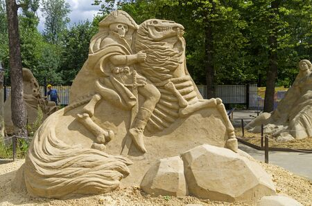konstantin: MOSCOW, RUSSIA - July 31, 2015. The exhibition of sand sculptures in Sokolniki Park. Composition Napoleon by Konstantin Kuzyarin reverse side.
