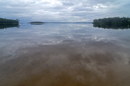 pista: Reflection of clouds in the clear lake. Lake Pistayarvi on Pistayoki river, Karelia, Russia.