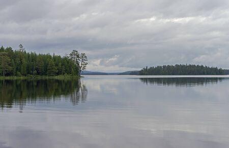 pista: Cloudy day on the lake. Lake Pistayarvi on Pistayoki river, Karelia, Russia.